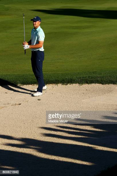 Jordan Spieth of the United States watches his second shot on the 18th hole during the third round of the Travelers Championship at TPC River...