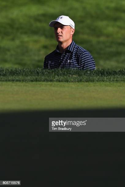 Jordan Spieth of the United States watches his shot from a bunker on the 18th green during the final round of the Travelers Championship at TPC River...