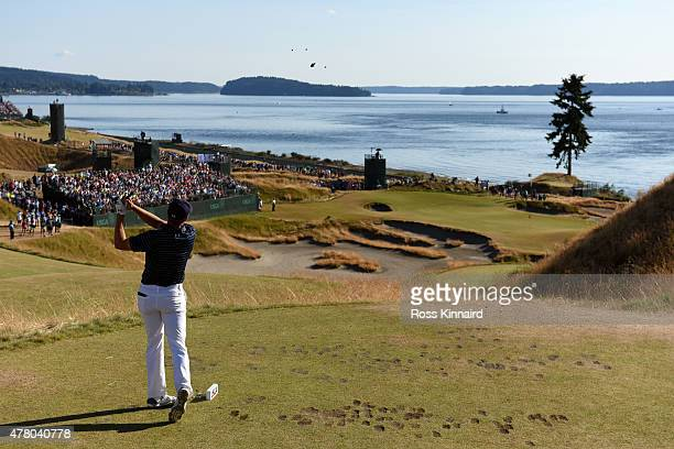 Jordan Spieth of the United States watches his tee shot on the 15th hole during the final round of the 115th US Open Championship at Chambers Bay on...