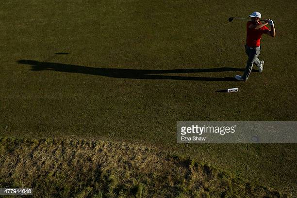 Jordan Spieth of the United States watches his tee shot on the 18th hole during the third round of the 115th US Open Championship at Chambers Bay on...