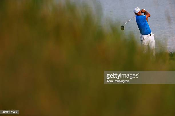 Jordan Spieth of the United States watches his tee shot on the 18th hole during the first round of the 2015 PGA Championship at Whistling Straits on...