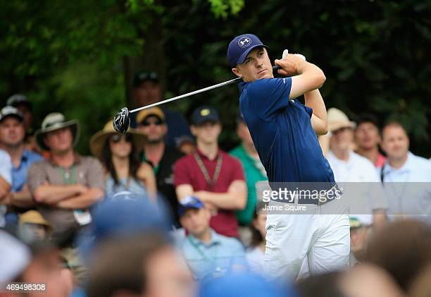 Jordan Spieth of the United States watches his tee shot on the seventh hole during the final round of the 2015 Masters Tournament at Augusta National...