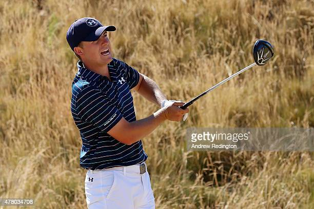 Jordan Spieth of the United States watches his tee shot on the seventh hole during the final round of the 115th US Open Championship at Chambers Bay...