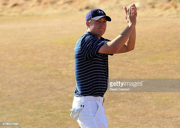 Jordan Spieth of the United States waves to the gallery after a birdie on the 18th green during the final round of the 115th US Open Championship at...