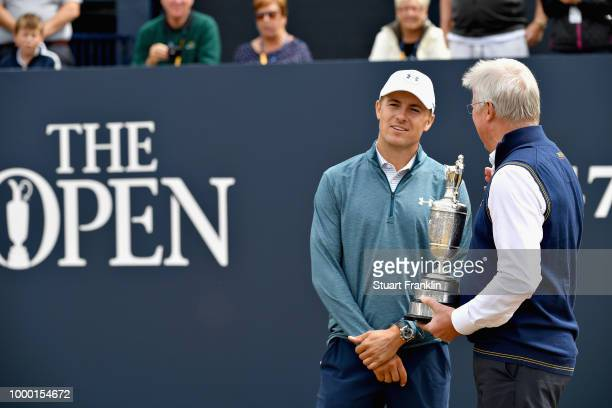 Jordan Spieth of the United States winner of the 146th Open Championship returns the Claret Jug to RA Chief Executive Martin Slumbers on the first...