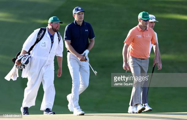 Jordan Spieth of the United States, Zach Johnson of the United States and J.T. Poston of the United States walk on the ninth hole during a practice...