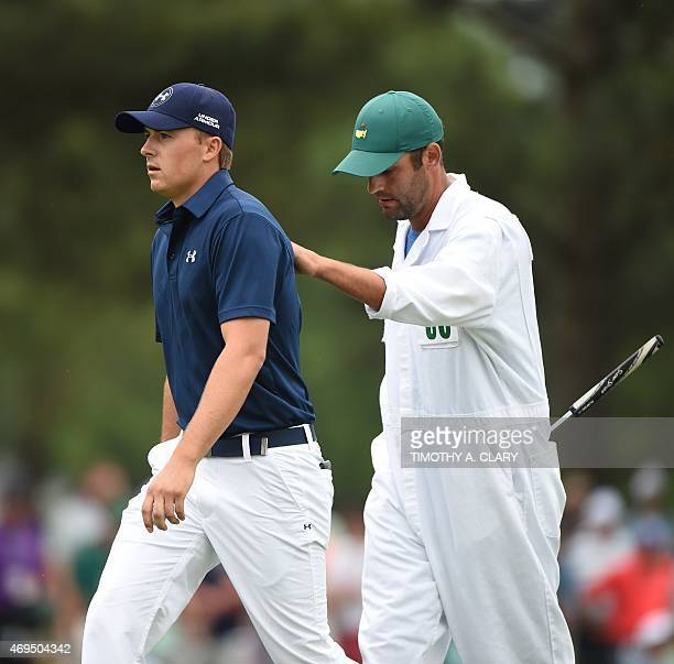 Jordan Spieth of the US gets a pat on the back from caddie Michael Greller during Round 4 of the 79th Masters Golf Tournament at Augusta National...