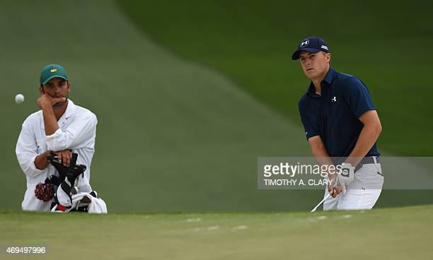 Jordan Spieth of the US hits a shot on the 7th hole during Round 4 of the 79th Masters Golf Tournament at Augusta National Golf Club on April 12 in...