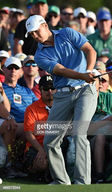 Jordan Spieth of the US makes a shot from the crowd at the18th hole during Round 3 of the 79th Masters Golf Tournament at Augusta National Golf Club...