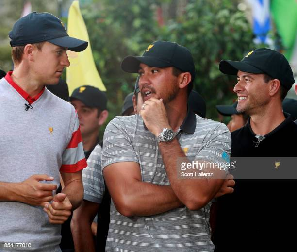 Jordan Spieth of the US Team Jason Day of Australia and the International Team and Adam Scott of Australia and the International Team chat on the set...