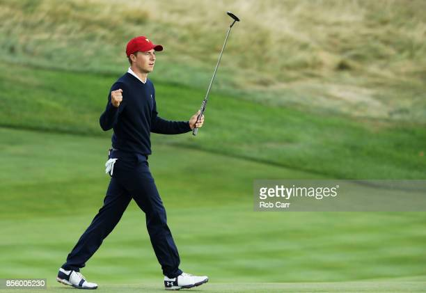 Jordan Spieth of the U.S. Team reacts on the 17th green after he and Patrick Reed defeated Louis Oosthuizen of South Africa and the International...