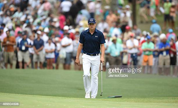 Jordan Spieth of the US walks on the 6th green during Round 4 of the 79th Masters Golf Tournament at Augusta National Golf Club on April 12 in...