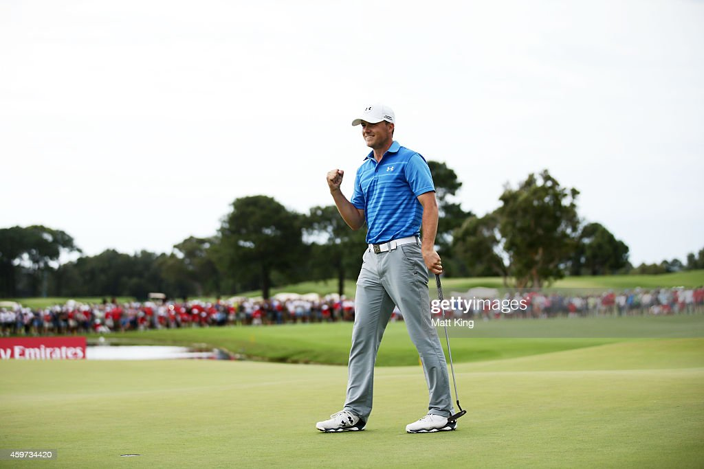 Jordan Spieth of the USA celebrates and acknowledges the crowd after putting on the 18th hole and winning the 2014 Australian Open during day four of the 2014 Australian Open at The Australian Golf Course on November 30, 2014 in Sydney, Australia.