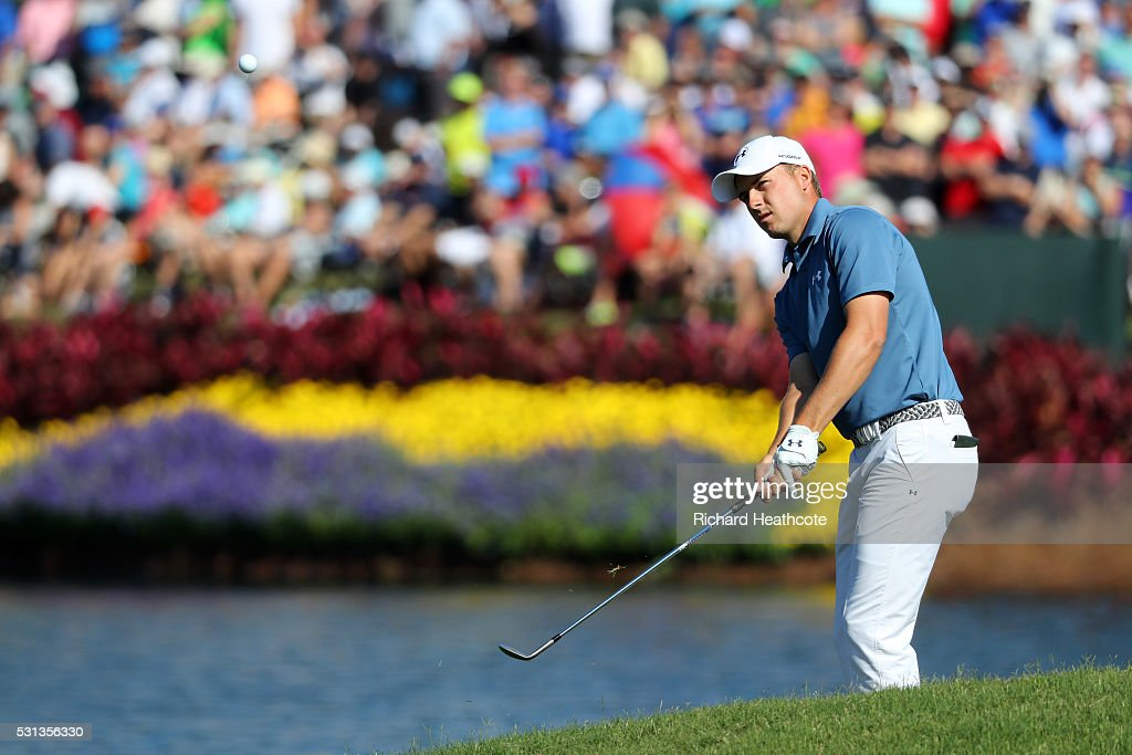 Jordan Spieth of the USA chips onto the 16th green during the resumption of the weather delayed second round of THE PLAYERS Championship at the Stadium course at TPC Sawgrass on May 14, 2016 in Ponte Vedra Beach, Florida.