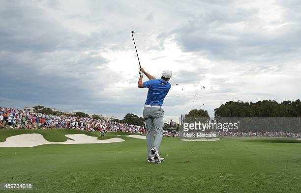 Jordan Spieth of the USA plays his approach shot on the 18th hole during day four of the 2014 Australian Open at The Australian Golf Course on...