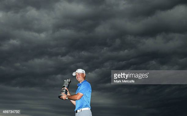 Jordan Spieth of the USA poses with the Stonehaven trophy after winning the 2014 Australian Open during day four of the 2014 Australian Open at The...