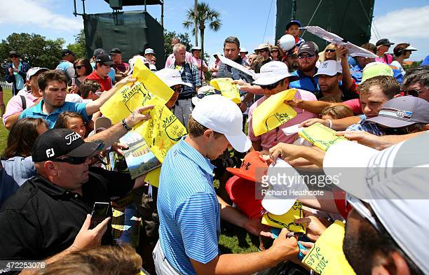 Jordan Spieth of the USA signs autographs for spectators after a practice round for THE PLAYERS Championship at TPC Sawgrass on May 5 2015 in Ponte...