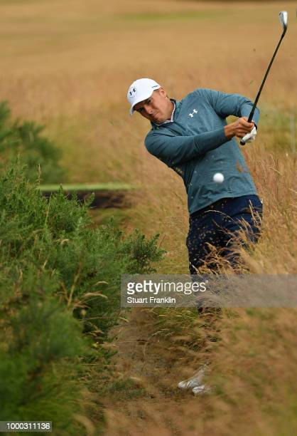 Jordan Spieth of USA plays a shot from a drainage ditch during practice prior to the start of the 147th Open Championship at Carnoustie Golf Club on...