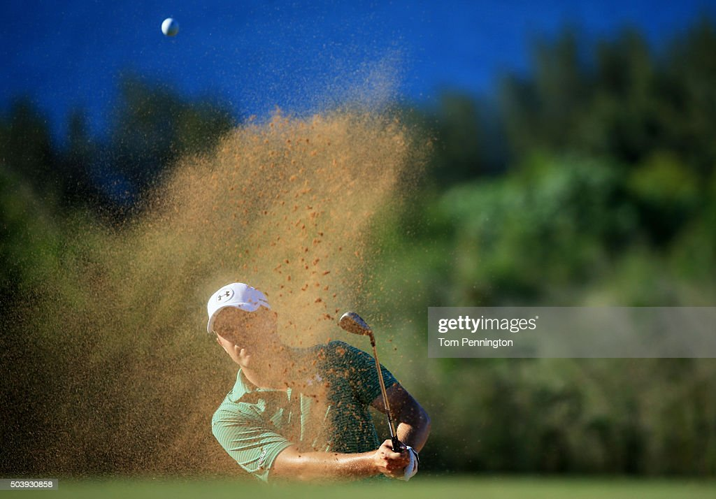 Jordan Spieth plays a shot from a bunker on the 14th hole during round one of the Hyundai Tournament of Champions at the Plantation Course at Kapalua Golf Club on January 7, 2016 in Lahaina, Hawaii.