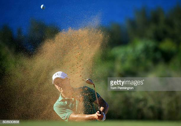 Jordan Spieth plays a shot from a bunker on the 14th hole during round one of the Hyundai Tournament of Champions at the Plantation Course at Kapalua...