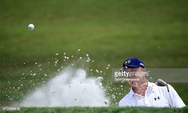 Jordan Spieth plays a shot from a bunker on the third hole during round two of THE PLAYERS Championship at the TPC Sawgrass Stadium course on May 8...