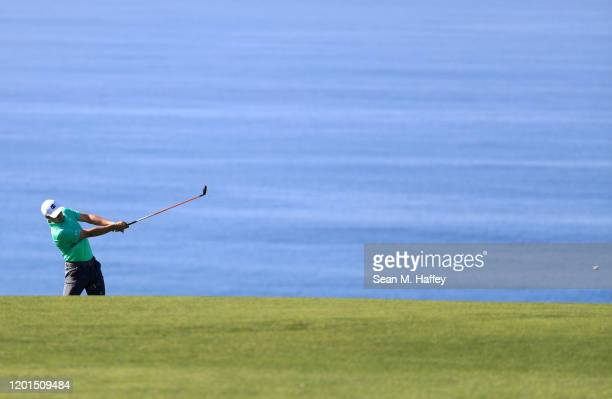 Jordan Spieth plays a shot on the fourth hole during the first round of the Farmers Insurance Open on Torrey Pines South on January 23, 2020 in San...