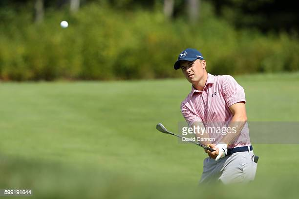 Jordan Spieth plays a shot on the fourth hole during the third round of the Deutsche Bank Championship at TPC Boston on September 4, 2016 in Norton,...