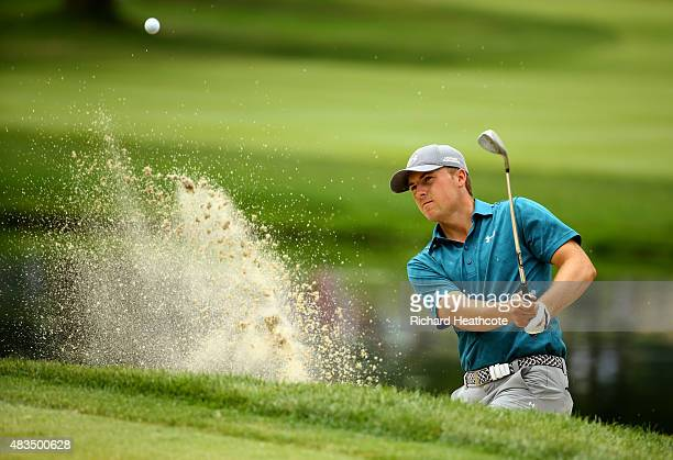 Jordan Spieth plays a shot out of a bunker near the third green during the final round of the World Golf Championships - Bridgestone Invitational at...
