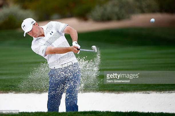 Jordan Spieth plays a shot out of a bunker on the second fairway during the first round of the Waste Management Phoenix Open at TPC Scottsdale on...