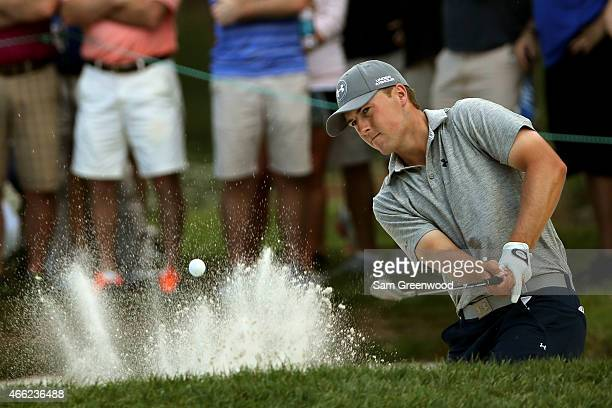 Jordan Spieth plays a shot out of a bunker on the third hole during the third round of the Valspar Championship at Innisbrook Resort Copperhead...