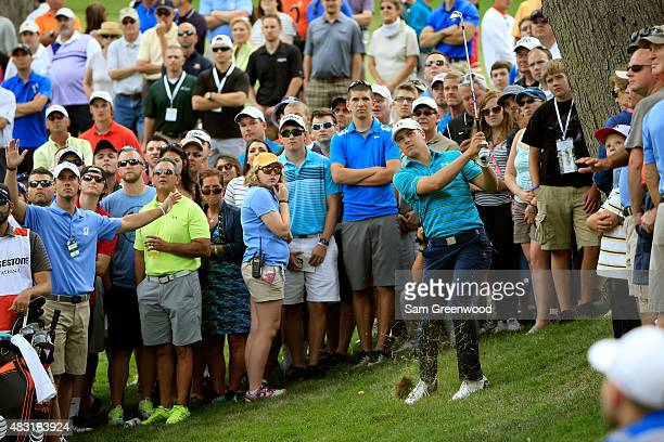 Jordan Spieth plays his second shot on the third hole during the first round of the World Golf Championships - Bridgestone Invitational at Firestone...