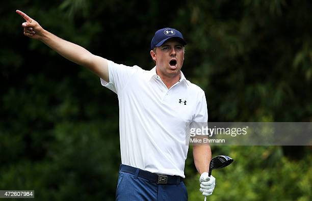 Jordan Spieth plays his shot from the 11th tee during round two of THE PLAYERS Championship at the TPC Sawgrass Stadium course on May 8 2015 in Ponte...