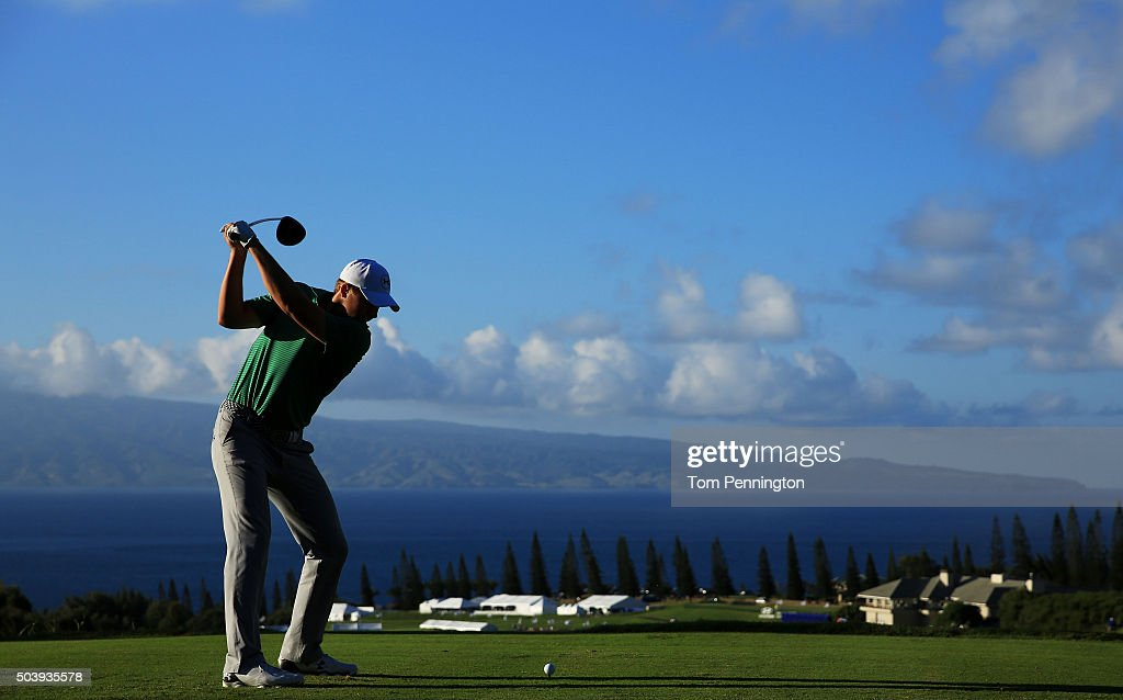 Jordan Spieth plays his shot from the 18th tee during round one of the Hyundai Tournament of Champions at the Plantation Course at Kapalua Golf Club on January 7, 2016 in Lahaina, Hawaii.