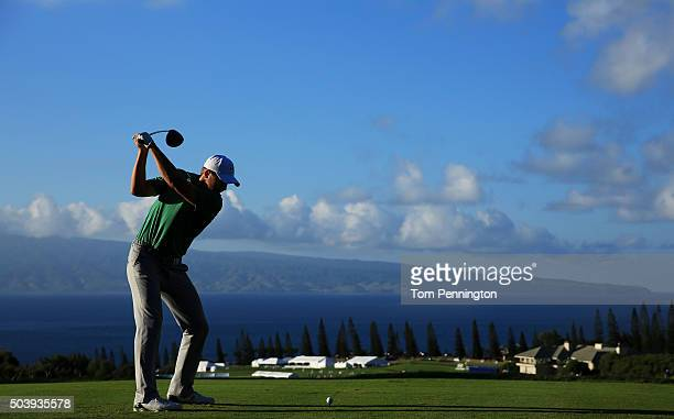 Jordan Spieth plays his shot from the 18th tee during round one of the Hyundai Tournament of Champions at the Plantation Course at Kapalua Golf Club...