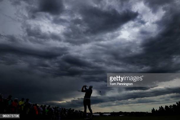Jordan Spieth plays his shot from the second tee after a four hour rain delay during the final round of the AT&T Byron Nelson at Trinity Forest Golf...
