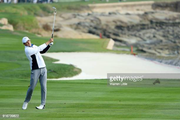 Jordan Spieth plays his shot on the 18th hole during Round Three of the ATT Pebble Beach ProAm at Spyglass Hill Golf Course on February 10 2018 in...