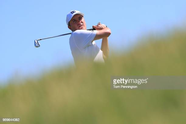 Jordan Spieth plays his tee shot on the 12th hole during the first round of the AT&T Byron Nelson at Trinity Forest Golf Club on May 17, 2018 in...