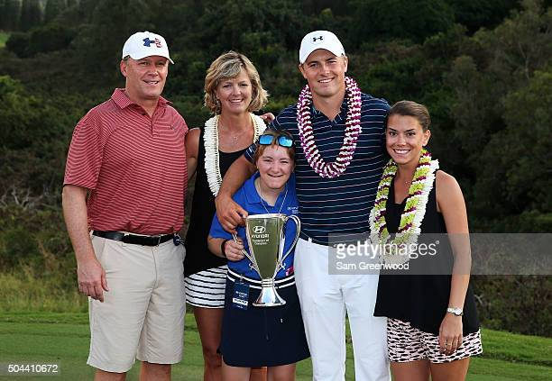Jordan Spieth poses on the 18th green with his mom Chris father Shawn sister Ellie and girlfriend Annie Verret after winning the final round of the...