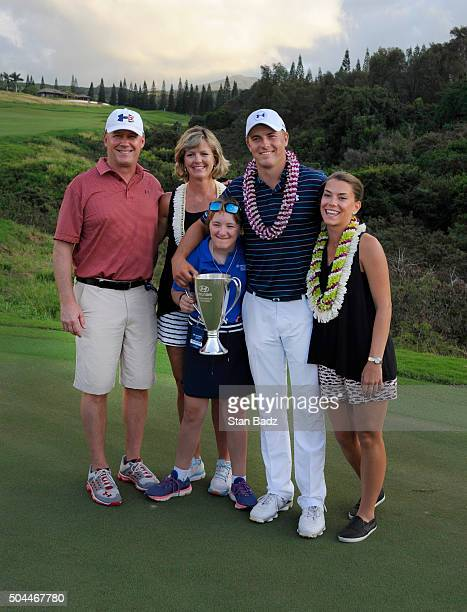 Jordan Spieth poses on the 18th green with his mom Chris, father Shawn, sister Ellie and girlfriend Annie Verret after winning the final round of the...