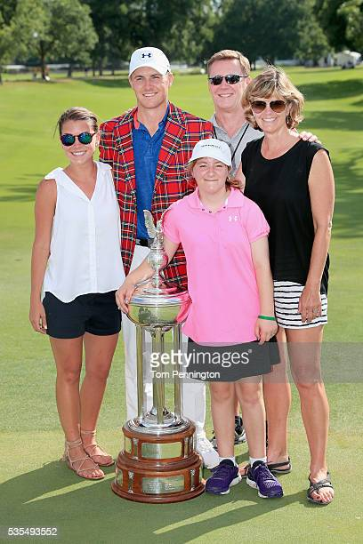 Jordan Spieth poses with the trophy with father Shawn mother Chris sister Ellie and girlfriend Annie Verret after winning the DEAN DELUCA...