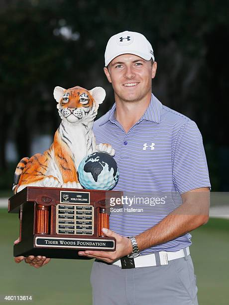 Jordan Spieth poses with the winner's trophy after his ten-stroke victory at the Hero World Challenge at the Isleworth Golf & Country Club on...