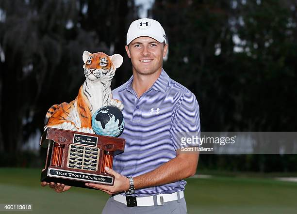 Jordan Spieth poses with the winner's trophy after his tenstroke victory at the Hero World Challenge at the Isleworth Golf Country Club on December 7...