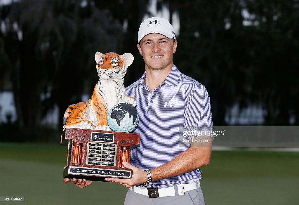 Jordan Spieth poses with the winner's trophy after his ten-stroke victory at the Hero World Challenge at the Isleworth Golf & Country Club on December 7, 2014 in Windermere, Florida.
