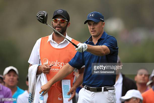 Jordan Spieth prepares to hit off the second tee with caddie Michael Greller during the final round of the Valspar Championship at Innisbrook Resort...