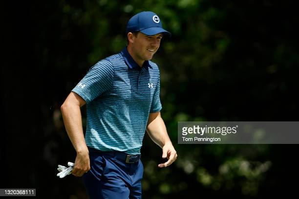 Jordan Spieth reacts after chipping in for birdie on the 8th hole during the first round of the Charles Schwab Challenge at Colonial Country Club on...