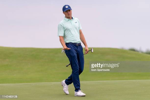 Jordan Spieth reacts after his putt on the ninth green during the first round of the ATT Byron Nelson on May 9 2019 at Trinity Forest Golf Club in...