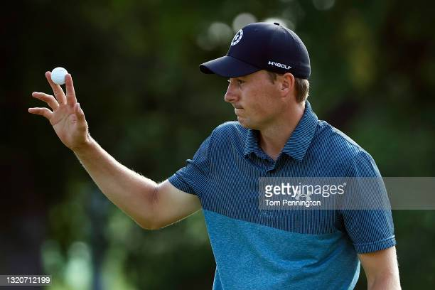 Jordan Spieth reacts after making a birdie putt on the 18th hole during the third round of the Charles Schwab Challenge at Colonial Country Club on...