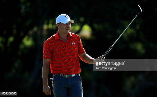 Jordan Spieth reacts after putting for eagle on the 18th green during the third round of the Hyundai Tournament of Champions at the Plantation Course...