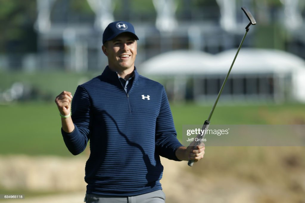 Jordan Spieth reacts after putting out on the 18th green to win the AT&T Pebble Beach Pro-Am at Pebble Beach Golf Links on February 12, 2017 in Pebble Beach, California.