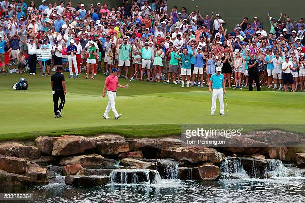 Jordan Spieth reacts to a birdie putt on the 17th hole as Brooks Koepka looks on during Round Three at the AT&T Byron Nelson on May 21, 2016 in...